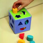 Shapes away to learning fun with a 'shape sorter'!